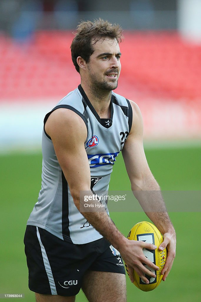 Steele Sidebottom kicks during a Collingwood Magpies AFL training session at Metricon Stadium on July 19, 2013 in Gold Coast, Australia.