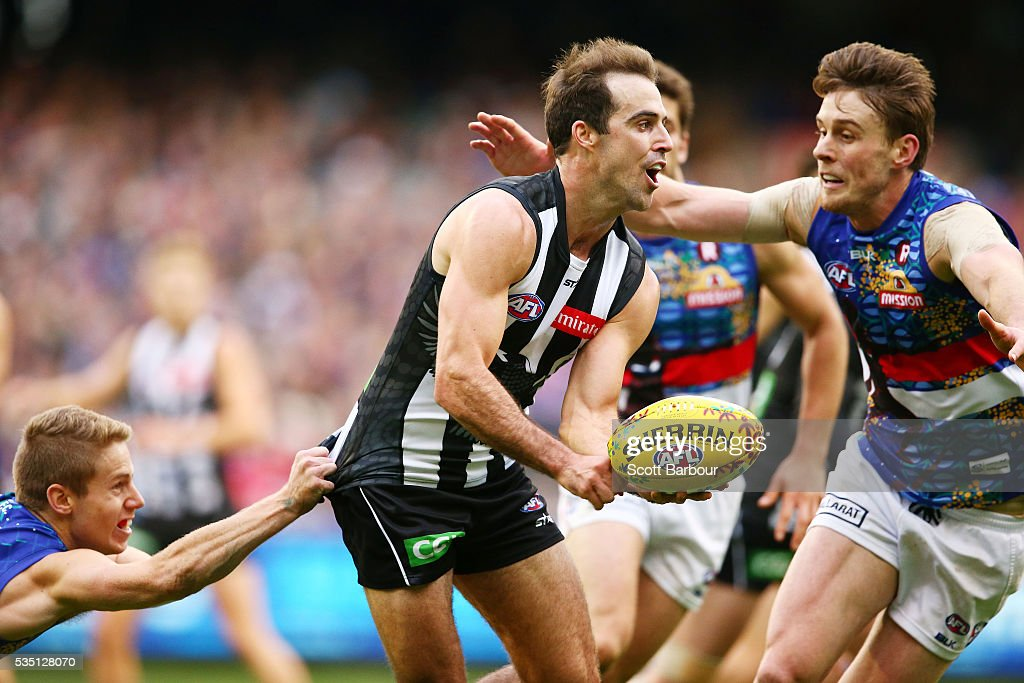 Steele Sidebottom of the Magpies compete for the ball during the round 10 AFL match between the Collingwood Magpies and the Western Bulldogs at Melbourne Cricket Ground on May 29, 2016 in Melbourne, Australia.
