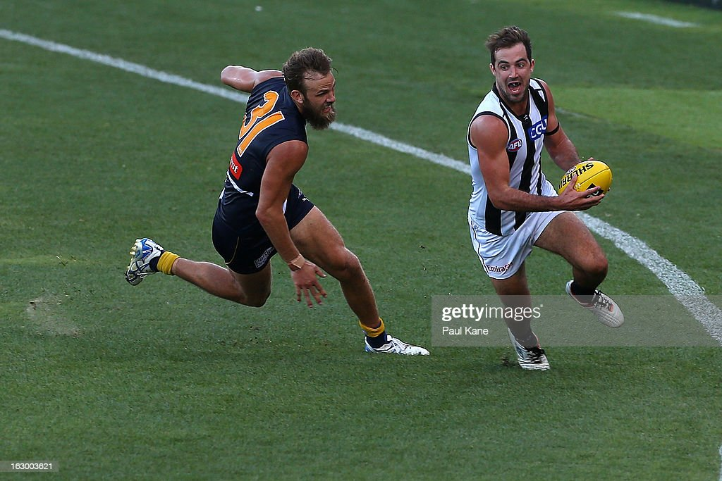 Steele Sidebottom of the Magpies evades Will Schofield of the Eagles during the round two AFL NAB Cup match between the West Coast Eagles and the Collingwood Magpies at Patersons Stadium on March 3, 2013 in Perth, Australia.