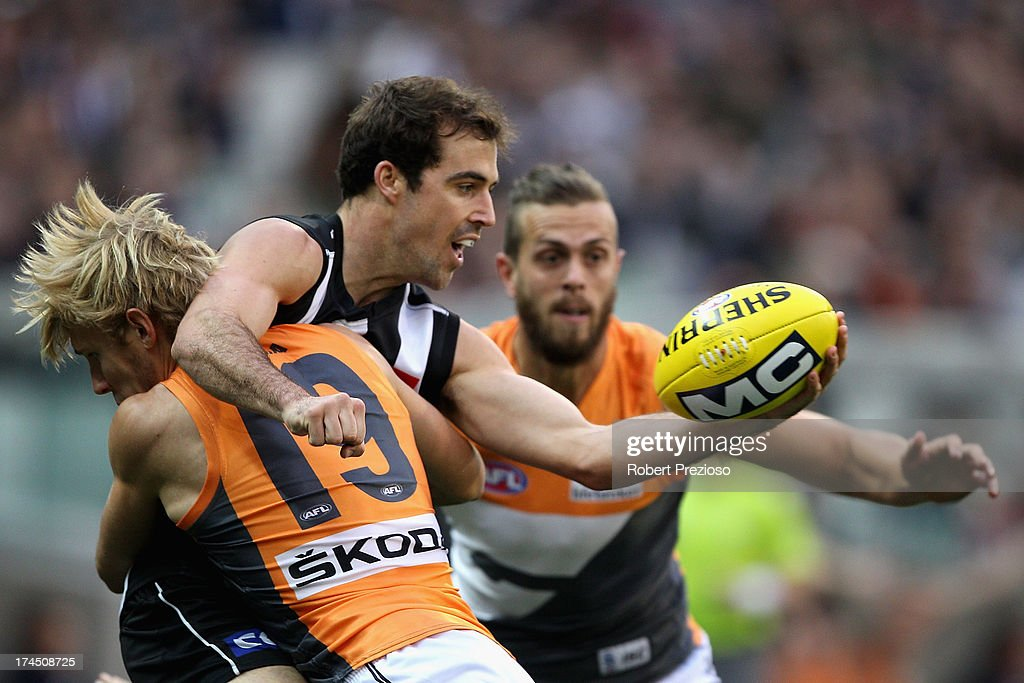 Steele Sidebottom of the Magpies is tackled during the round 18 AFL match between the Collingwood Magpies and the Greater Western Sydney Giants at Melbourne Cricket Ground on July 27, 2013 in Melbourne, Australia.