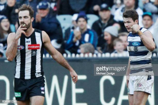 Steele Sidebottom of the Magpies reacts after defeat as Patrick Dangerfield of the Cats celebrates on th final siren during the round 22 AFL match...