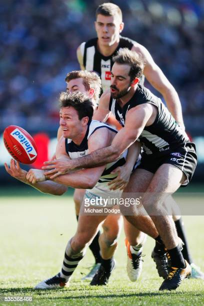 Steele Sidebottom of the Magpies tackles Patrick Dangerfield of the Cats during the round 22 AFL match between the Collingwood Magpies and the...