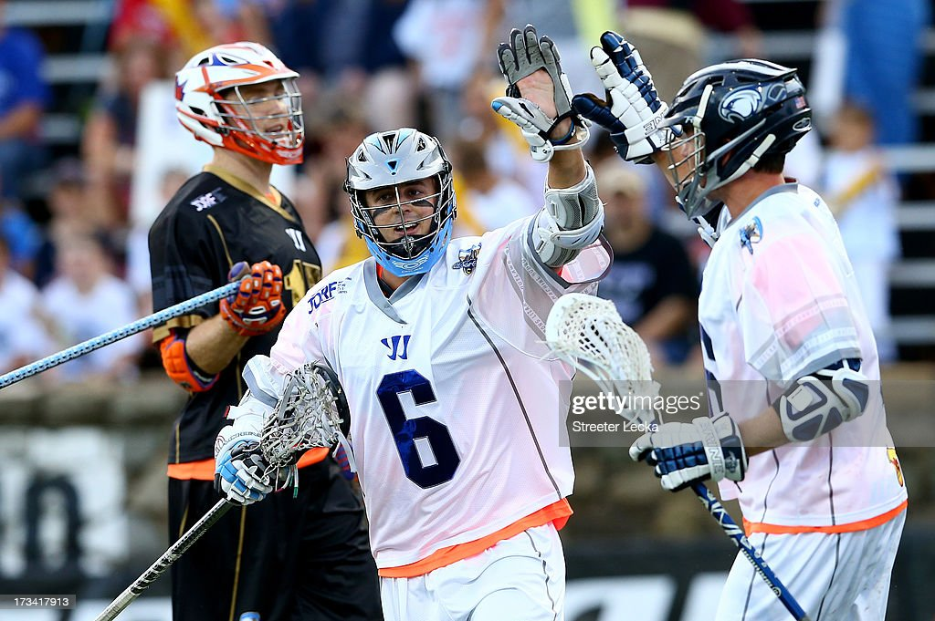 Steele Stanwick #6 of Supernova celebrates after scoring a goal against Eclipse during the 2013 Major League Lacrosse All Star Game at American Legion Memorial Stadium on July 13, 2013 in Charlotte, North Carolina.