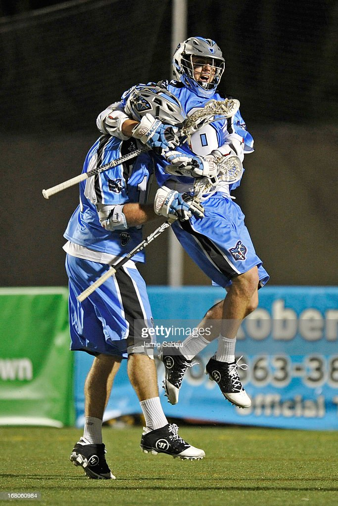 Steele Stanwick #6 of the Ohio Machine celebrates with Eric O'Brien #10 of the Ohio Machine after O'Brien scored a goal against the Denver Outlaws in the second half on May 4, 2013 at Selby Stadium in Delaware, Ohio. Denver defeated Ohio 13-8.