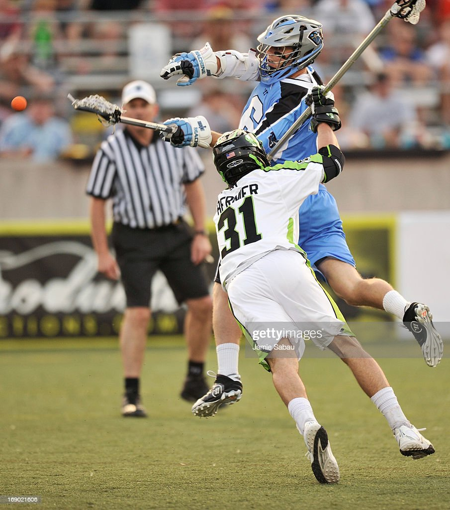 Steele Stanwick #6 of the Ohio Machine fires a shot on goal past the defense of Matt Bernier #31 of the New York Lizards in the first period on May 18, 2013 at Selby Stadium in Delaware, Ohio.
