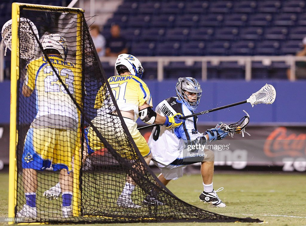 Steele Stanwick #6 of the Ohio Machine is defended by Tucker Durkin #51 of the Florida Launch during the second half of the game at Florida Atlantic University Stadium on May 10, 2014 in Boca Raton, Florida.