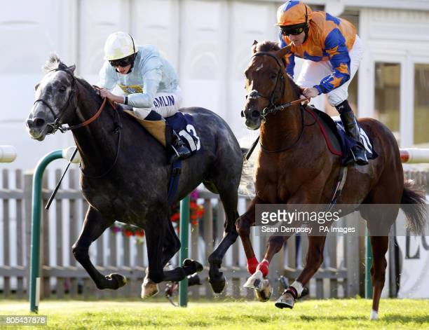 Steele Tango ridden by Liam Keniry goes on to win the Thurlow Nunn Standen Darley Stakes ahead of Glass Harmonium ridden by Ryan Moore during the...