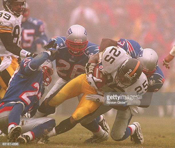 Steelers' Fred McAfee is brought down by Patriots' Lawyer Milloy and Jerome Henderson as Mike McGruder helps New England Patriots face the Pittsburgh...