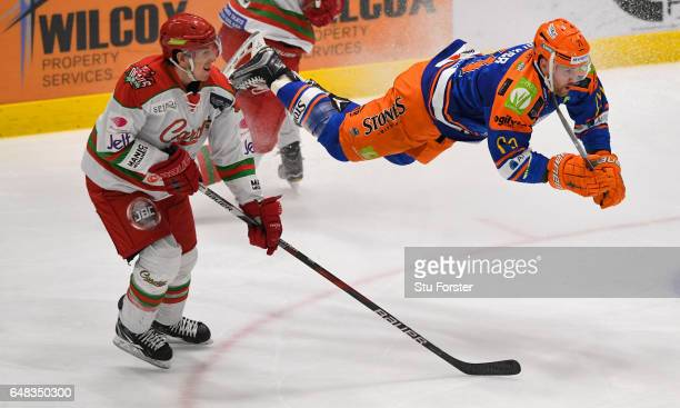 Steelers player Geoff Walker is sent flying during the Ice Hockey Elite League Challenge Cup Final between Sheffield Steelers and Cardiff Devils at...