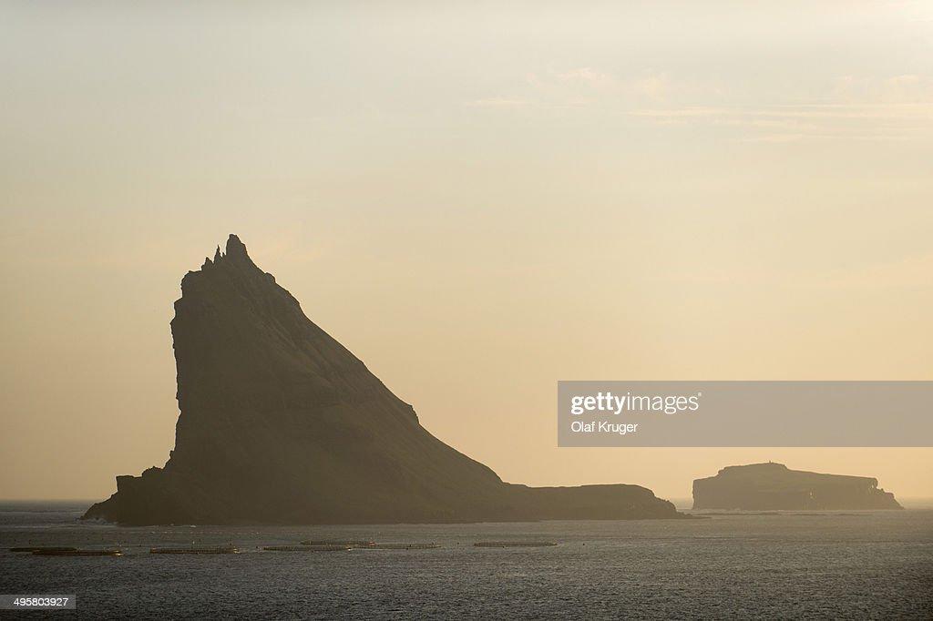 Steep towering rocks off Vagar, Vagar, Faroe Islands, Denmark