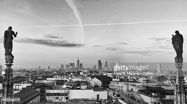 Steeple Of Milan Cathedral Against Cityscape And Sky