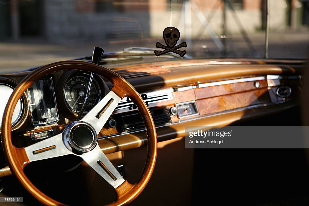 Steering wheel and dashboard of a vintage car : Stock Photo