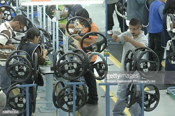 Steering wheel manufacturing at Delphi Delco Electronics de Mexico a maquiladora plant across the US border The company makes parts for General...
