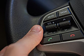 Steering wheel with control buttons close-up. Car stereo system control