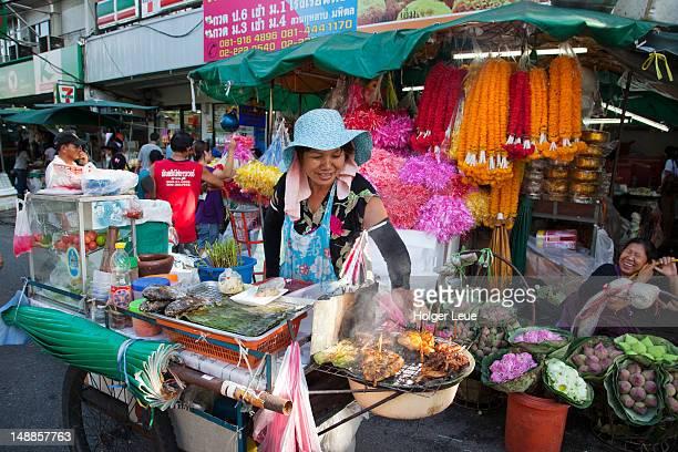 Steet vendor grilling chicken near Flower Market.