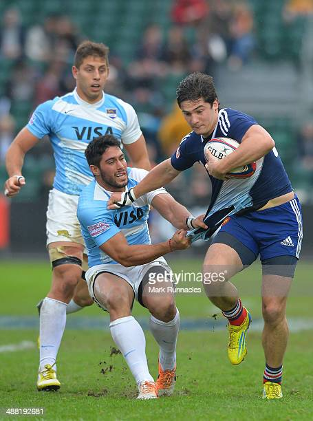 Steeve Barry of France is tackled by Agustin Cortes of Argentina during the IRB Glasgow Sevens Day Two at Scotstoun Stadium on May 4 2014 in Glasgow...