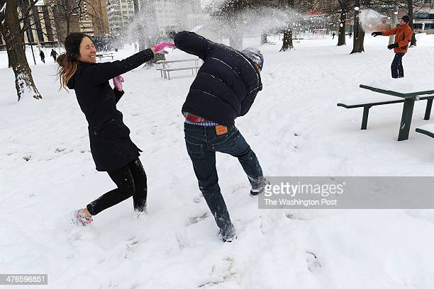 Stef Krongos and Richard Park have a snowball fight in Quincy Park following an organized snowball fight called Battle at Ballston which was...