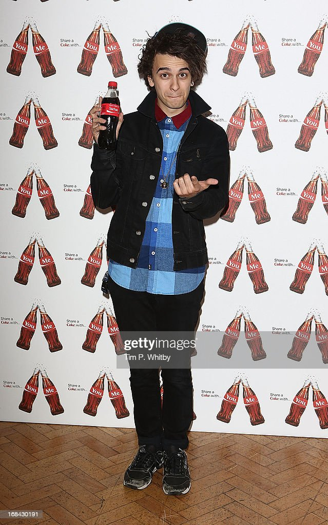 Stefan Abingdon with his personalised Coke bottle at the launch of Coca-Cola's, Share a Coke campaign at One Marylebone on May 9, 2013 in London, England.