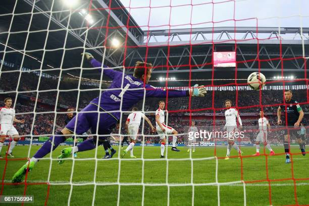 Stefan Aigner of 1860 Muenchen scores his team's first goal past goalkeeper Michael Rensing of Duesseldorf during the Second Bundesliga match between...