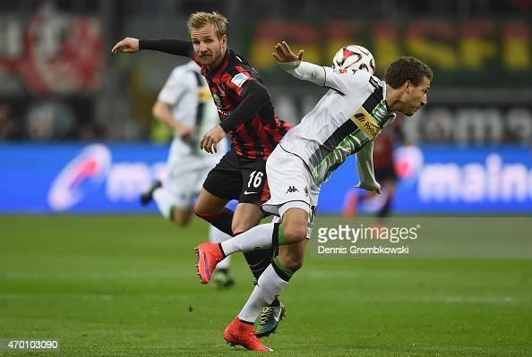 Stefan Aigner of Eintracht Frankfurt challenges Fabian Johnson of Borussia Moenchengladbach during the Bundesliga match between Eintracht Frankfurt...