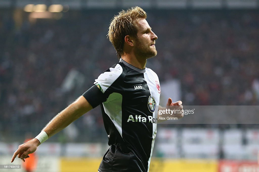 Stefan Aigner of Frankfurt celebrates his team's second goal during the DFB Cup second round match between Eintracht Frankfurt and VfL Bochum at Commerzbank-Arena on September 25, 2013 in Frankfurt am Main, Germany.
