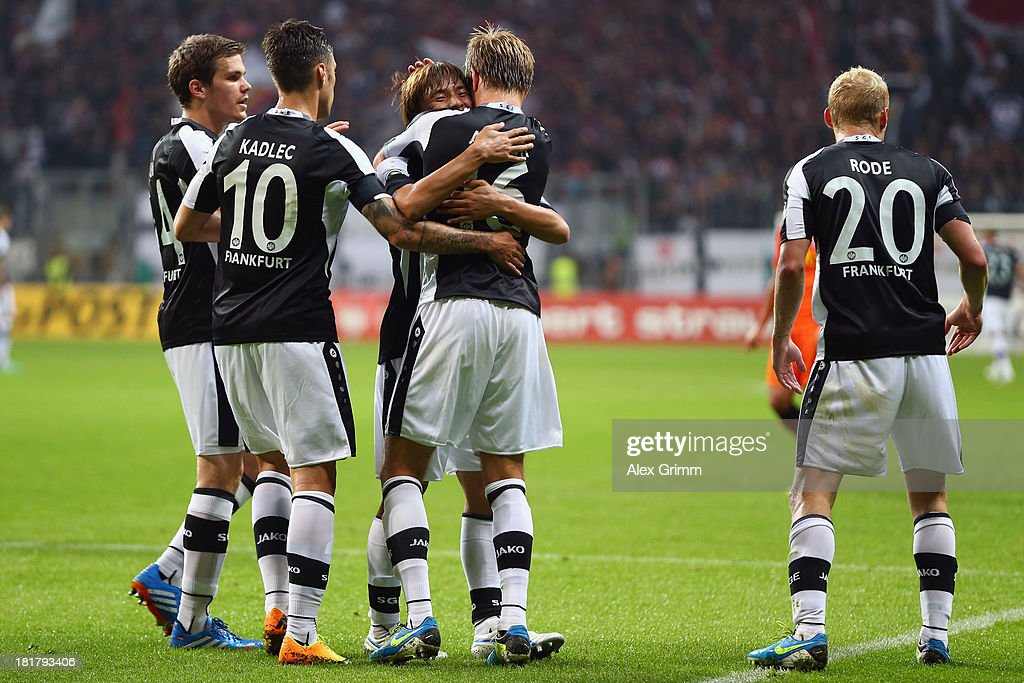 Stefan Aigner (2R) of Frankfurt celebrates his team's second goal with team mates Sebastian Jung, Vaclav Kadlec, Takashi Inui and Sebastian Rode (L-R) during the DFB Cup second round match between Eintracht Frankfurt and VfL Bochum at Commerzbank-Arena on September 25, 2013 in Frankfurt am Main, Germany.