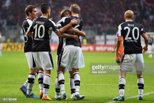 Stefan Aigner of Frankfurt celebrates his team's second goal with team mates Sebastian Jung Vaclav Kadlec Takashi Inui and Sebastian Rode during the...