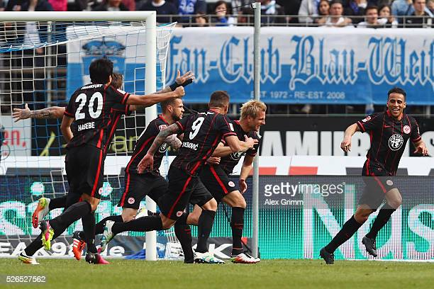 Stefan Aigner of Frankfurt celebrates his team's second goal with team mates during the Bundesliga match between SV Darmstadt 98 and Eintracht...