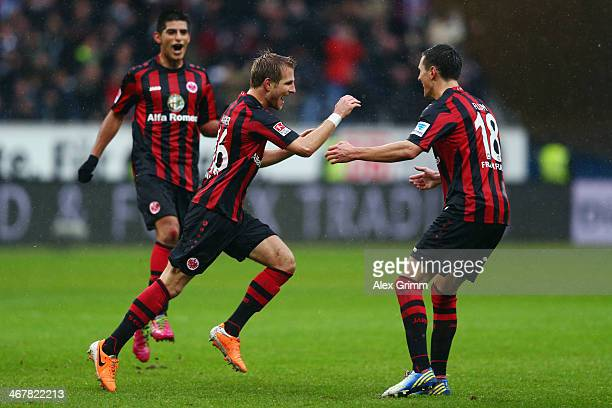Stefan Aigner of Frankfurt celebrates his team's third goal with team mates Carlos Zambrano and Johannes Flum during the Bundesliga match between...