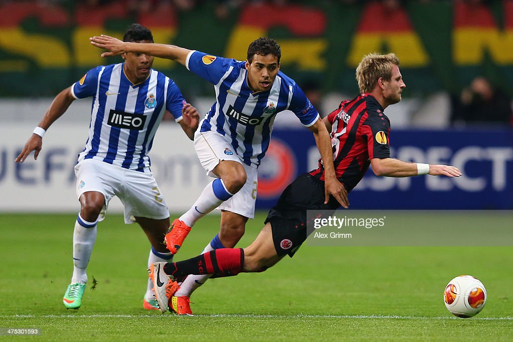 <a gi-track='captionPersonalityLinkClicked' href=/galleries/search?phrase=Stefan+Aigner&family=editorial&specificpeople=764034 ng-click='$event.stopPropagation()'>Stefan Aigner</a> of Frankfurt is challenged by Carlos Eduardo and Alex Sandro (R-L) of Porto during the UEFA Europa League Round of 32 second leg match between Eintracht Frankfurt and FC Porto at Commerzbank Arena on February 27, 2014 in Frankfurt am Main, Germany.
