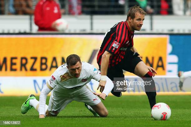 Stefan Aigner of Frankfurt is challenged by Oliver Fink of Duesseldorf during the Bundesliga match between Eintracht Frankfurt and Fortuna...