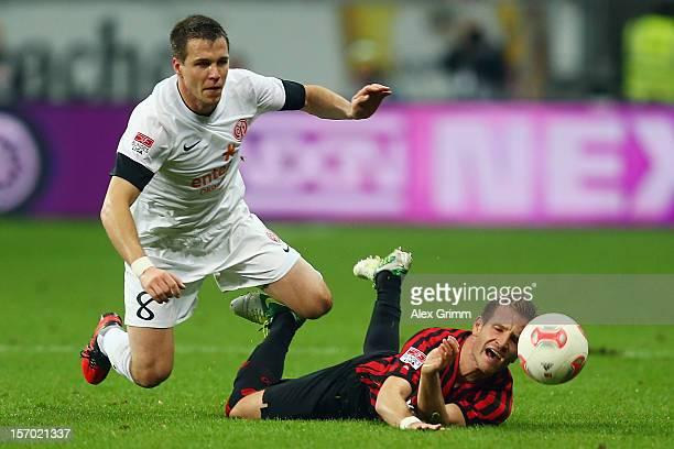 Stefan Aigner of Frankfurt is challenged by Radoslav Zabavnik of Mainz during the Bundesliga match between Eintracht Frankfurt and 1 FSV Mainz 05 at...