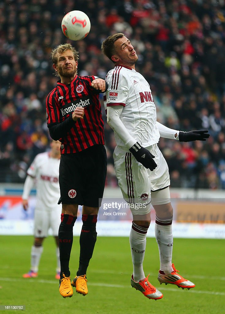 <a gi-track='captionPersonalityLinkClicked' href=/galleries/search?phrase=Stefan+Aigner&family=editorial&specificpeople=764034 ng-click='$event.stopPropagation()'>Stefan Aigner</a> (L) of Frankfurt jumps for a header with <a gi-track='captionPersonalityLinkClicked' href=/galleries/search?phrase=Tomas+Pekhart&family=editorial&specificpeople=9127519 ng-click='$event.stopPropagation()'>Tomas Pekhart</a> of Nuernberg during the Bundesliga match between Eintracht Frankfurt and 1. FC Nuernberg at Commerzbank-Arena on February 9, 2013 in Frankfurt am Main, Germany.