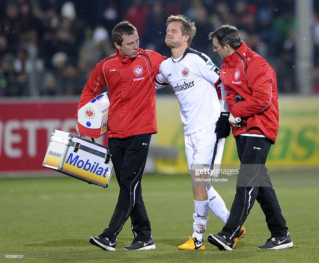 Stefan Aigner of Frankfurt leaving the field injured during the Bundesliga match between SC Freiburg and Eintracht Frankfurt at MAGE SOLAR Stadium on February 22, 2013 in Freiburg, Germany.