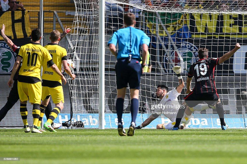Stefan Aigner of Frankfurt scores his team's first goal against goalkeeper Roman Buerki of Dortmund during the Bundesliga match between Eintracht...
