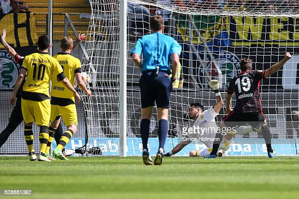 Stefan Aigner of Frankfurt scores his team's first goal against goalkeeper Roman Buerki of Dortmund during the Bundesliga match between Eintracht...