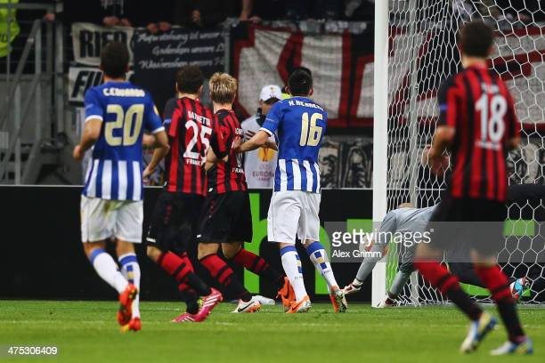 Stefan Aigner of Frankfurt scores his team's first goal during the UEFA Europa League Round of 32 second leg match between Eintracht Frankfurt and FC...
