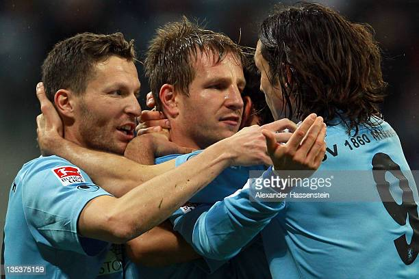 Stefan Aigner of Muenchen celebrates scoring the opening goal with his team mates Benjamin Lauth and Djordje Rakic during the Second Bundesliga match...
