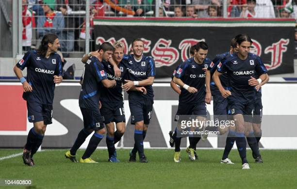 Stefan Aigner of Muenchen celebrates with his teammates after scoring 10 during the Second Bundesliga match between FC Augsburg v 1860 Muenchen at...