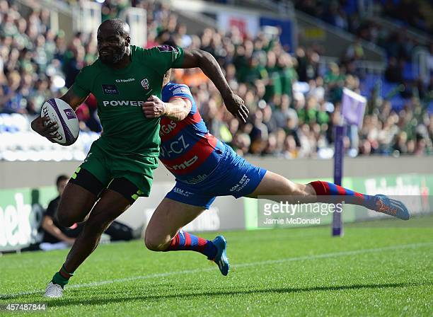 Stefan Basson of Rovigo fails to stop Topsy Ojo of London Irish from scoring a try during the European Rugby Challenge Cup match between London Irish...