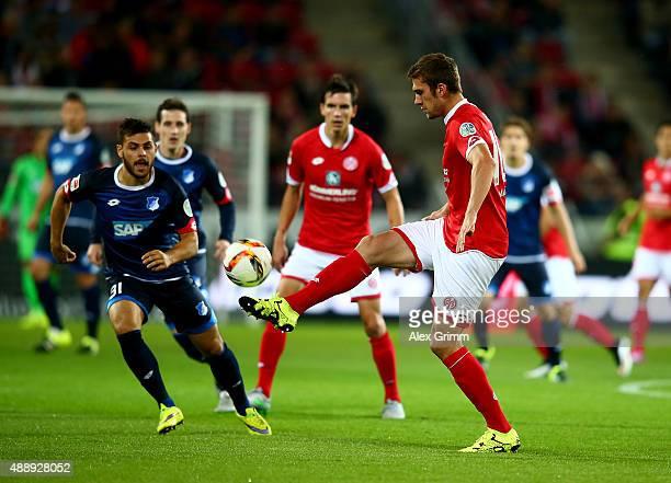 Stefan Bell of Mainz and Kevin Volland of Hoffenheim battle for the ball during the Bundesliga match between 1 FSV Mainz 05 and 1899 Hoffenheim at...