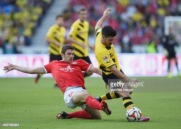 Stefan Bell of Mainz and Milos Jojic of Dortmund compete for the ball during the Bundesliga match between 1 FSV Mainz 05 and Borussia Dortmund at...