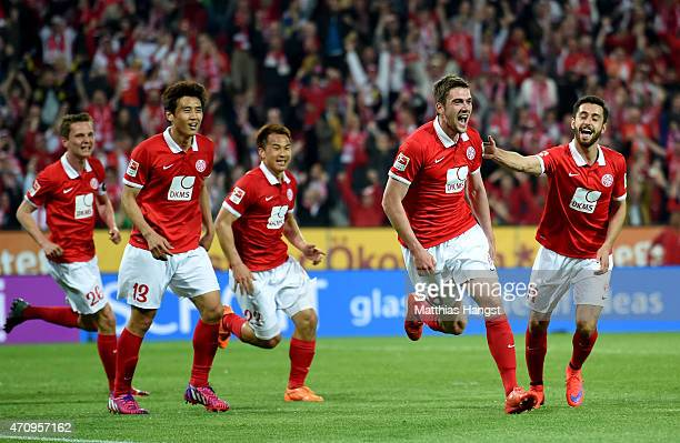 Stefan Bell of Mainz celebrate with his team mates after scoring the opening goal during the Bundesliga match between 1 FSV Mainz 05 and FC Schalke...