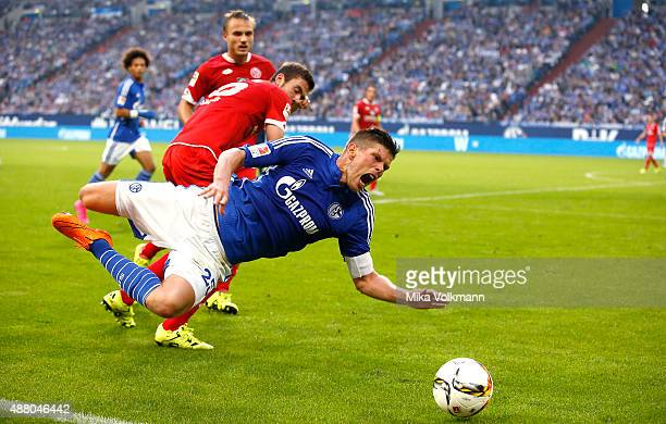 Stefan Bell of Mainz fouls Klaas Jan Huntelaar of Schalke during the Bundesliga match between FC Schalke 04 and 1 FSV Mainz 05 at VeltinsArena on...