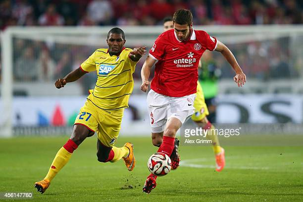 Stefan Bell of Mainz is challenged by Anthony Modeste of Hoffenheim during the Bundesliga match between 1 FSV Mainz 05 and 1899 Hoffenheim at Coface...
