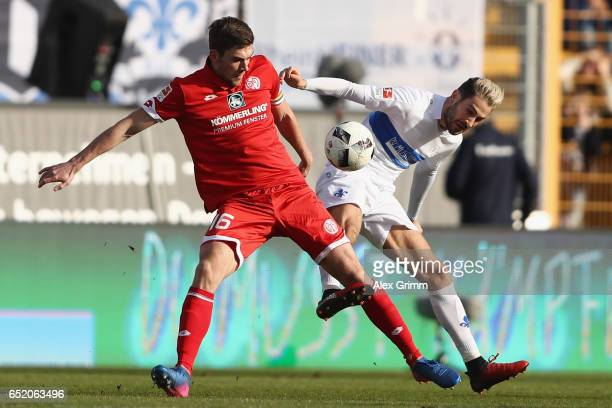 Stefan Bell of Mainz is challenged by Mario Vrancic of Darmstadt during the Bundesliga match between SV Darmstadt 98 and 1 FSV Mainz 05 at...