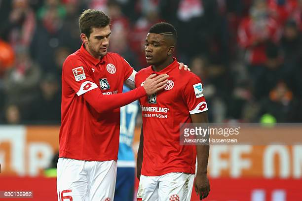 Stefan Bell of Mainz reacts with his team mate Jhon Cordoba during the Bundesliga match between 1 FSV Mainz 05 and Hamburger SV at Opel Arena on...