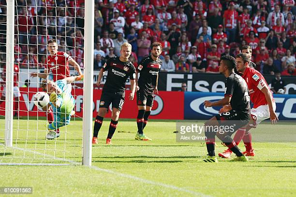 Stefan Bell of Mainz scores his team's second goal against goalkeeper Bernd Leno of Leverkusen during the Bundesliga match between 1 FSV Mainz 05 and...