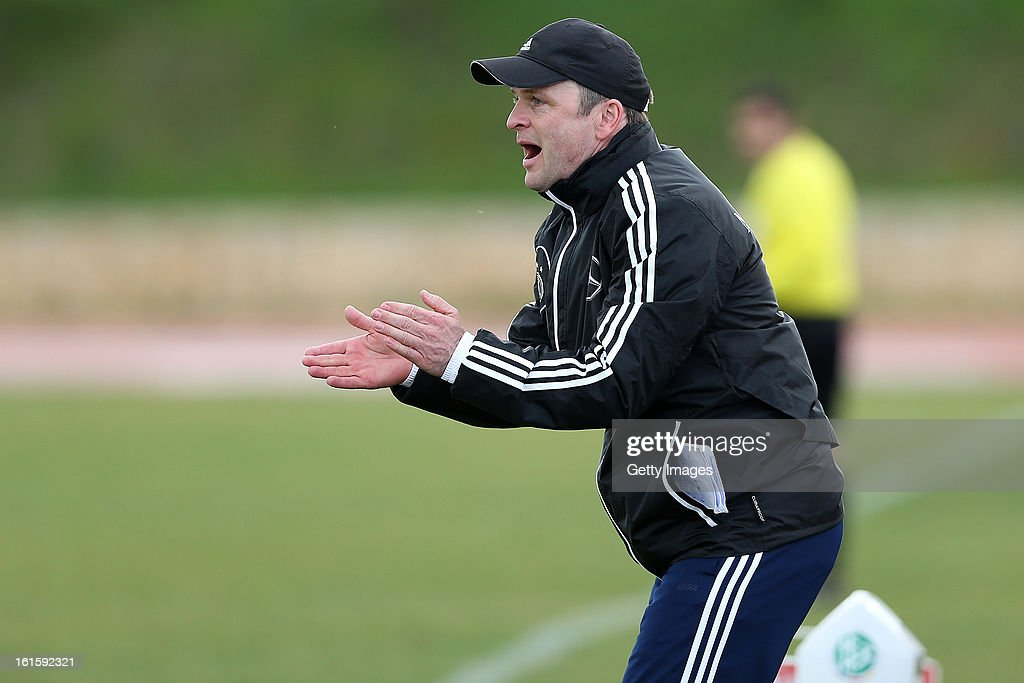 <a gi-track='captionPersonalityLinkClicked' href=/galleries/search?phrase=Stefan+Boeger&family=editorial&specificpeople=796201 ng-click='$event.stopPropagation()'>Stefan Boeger</a>, head coach of Germany reacts during the Under17 Algarve Youth Cup match between U17 Portugal and U17 Germany at the Stadium Bela Vista on February 12, 2013 in Parchal, Portugal.