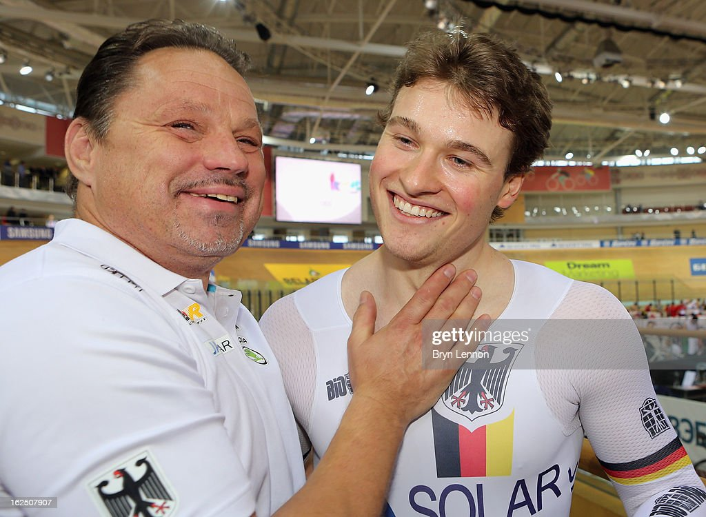 Stefan Botticher of Germany celebrates with Head Coach Detlef Uibel after winning the Men's Sprint Final during day five of the 2013 UCI Track World Championships at the Minsk Arena on February 24, 2013 in Minsk, Belarus.